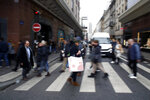 Pedestrians walk near a department store in Paris, Thursday, Dec.19, 2019. French retailers, hotels and cafes are struggling at the height of the holiday shopping season, because a protracted transportation strike and repeated protests in Paris and other cities are keeping shoppers and visitors away. And it's the second year in a row _ last year's Christmas season was hit by yellow vest protests. (AP Photo/Thibault Camus)