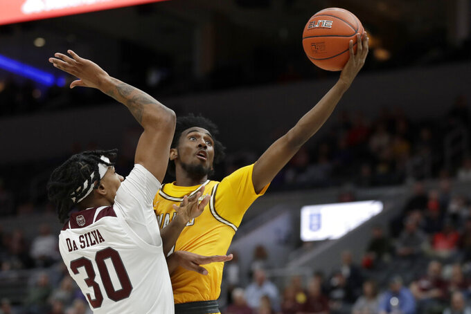 Valparaiso's Javon Freeman-Liberty, right, heads to the basket as Missouri State's Tulio Da Silva (30) defends during the first half of an NCAA college basketball game in the semifinal round of the Missouri Valley Conference men's tournament Saturday, March 7, 2020, in St. Louis. (AP Photo/Jeff Roberson)