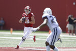 Indiana quarterback Peyton Ramsey (12) throws against Connecticut linebacker Omar Fortt (27) during the second half of an NCAA college football game, Saturday, Sept. 21, 2019, in Bloomington, Ind. Indiana won 38-3. (AP Photo/Darron Cummings)