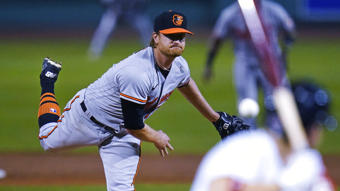 Baltimore Orioles starting pitcher Alex Cobb watches a delivery during the second inning of the team's baseball game against the Boston Red Sox at Fenway Park in Boston, Thursday, Sept. 24, 2020. (AP Photo/Charles Krupa)