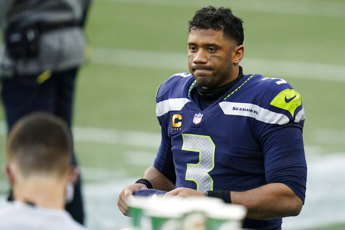 Seattle Seahawks quarterback Russell Wilson reacts on the sideline during the second half of an NFL football game against the New York Giants, Sunday, Dec. 6, 2020, in Seattle. (AP Photo/Elaine Thompson)