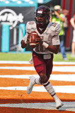 Bethune-Cookman quarterback Akevious Williams drops back to pass during the first half of an NCAA college football game against Miami, Saturday, Sept. 14, 2019, in Miami Gardens, Fla. (AP Photo/Wilfredo Lee)