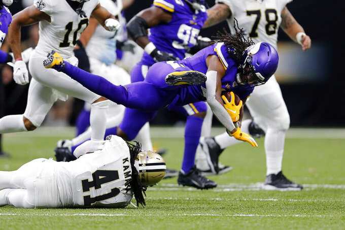 New Orleans Saints running back Alvin Kamara (41) takes Minnesota Vikings defensive back Anthony Harris on an interception in the first half of an NFL wild-card playoff football game, Sunday, Jan. 5, 2020, in New Orleans. (AP Photo/Brett Duke)