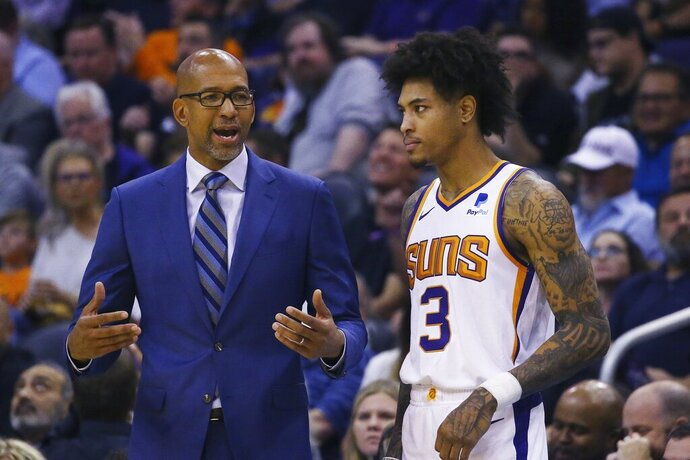 Phoenix Suns head coach Monty Williams, left, talks with Suns forward Kelly Oubre Jr. (3) during the first half of an NBA basketball game against the Philadelphia 76ers, Monday, Nov. 4, 2019, in Phoenix. (AP Photo/Ross D. Franklin)