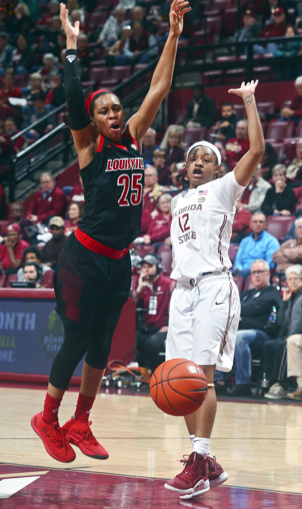 Louisville guard Asia Durr (25) is fouled by Florida State guard Nicole Ekhomu (12) as she goes for a layup during the second half of an NCAA college basketball game in Tallahassee, Fla., Thursday, Jan. 24, 2019. (AP Photo/Phil Sears)