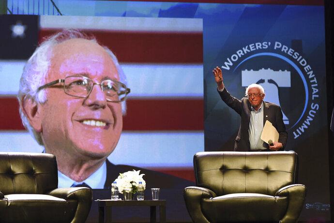 Democratic presidential candidate U.S. Sen. Bernie Sanders arrives onstage at the