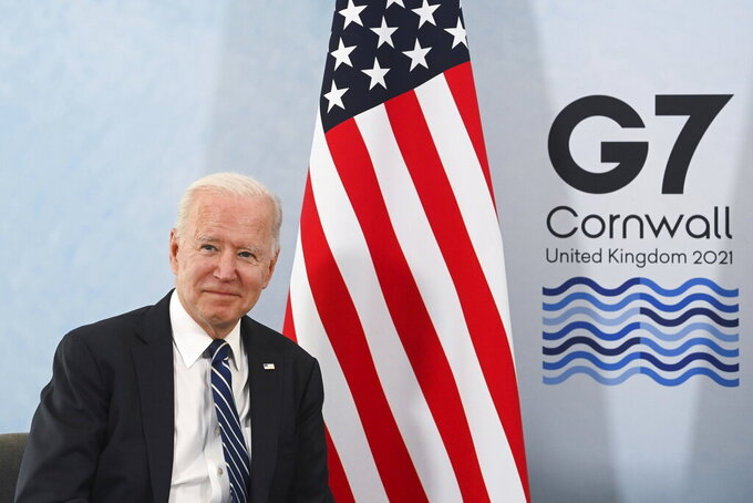 U.S. President Joe Biden poses for a picture during a meeting with Britain's Prime Minister Boris Johnson (not pictured) ahead of the G7 summit Carbis Bay Hotel, Carbis Bay, Cornwall, Britain, Thursday June 10, 2021. (Toby Melville/Pool Photo via AP)