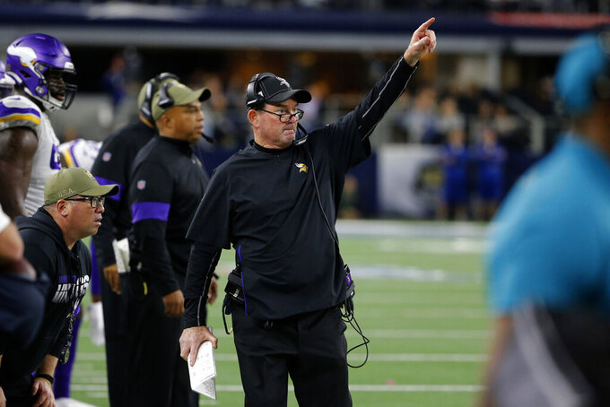 Minnesota Vikings coach Mike Zimmer signals from the sideline during the second half of the team's NFL football game against the Dallas Cowboys in Arlington, Texas, Sunday, Nov. 10, 2019. (AP Photo/Michael Ainsworth)