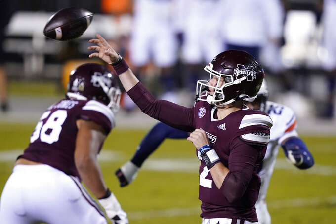 Mississippi State quarterback Will Rogers (2) throws a pass against Auburn during the first half of an NCAA college football game Saturday, Dec. 12, 2020, in Starkville, Miss. (AP Photo/Rogelio V. Solis)