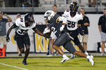 Central Florida wide receiver Kaedin Robinson (2) runs past Bethune-Cookman cornerbacks Malik Franklin (33) and Henry Miller II (28) for a touchdown on a 30-yard pass play during the second half of an NCAA college football game, Saturday, Sept. 11, 2021, in Orlando, Fla. (AP Photo/John Raoux)