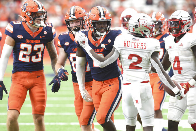 Syracuse defensive end Marlowe Wax gets in the face of Rutgers wide receiver Aron Cruickshank (2) after a tackle in the second half of an NCAA college football game, Saturday, Sept. 11, 2021, at the Carrier Dome in Syracuse, N.Y. (Dennis Nett/The Post-Standard via AP)