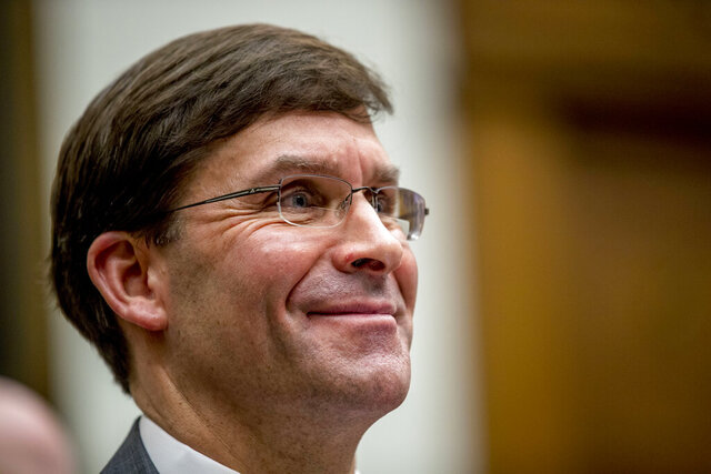 Defense Secretary Mark Esper smiles during a House Armed Services Committee hearing on Capitol Hill, Wednesday, Feb. 26, 2020, in Washington. (AP Photo/Andrew Harnik)
