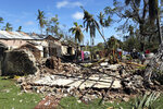 Clothes are seen on a drying line at a house damaged by Cyclone Kenneth in Ibo island north of Pemba city in Mozambique, Wednesday, May, 1, 2019. The government has said more than 40 people have died after the cyclone made landfall on Thursday, and the humanitarian situation in Pemba and other areas is dire. More than 22 inches (55 centimeters) of rain have fallen in Pemba since Kenneth arrived just six weeks after Cyclone Idai tore into central Mozambique. (AP Photo/Tsvangirayi Mukwazhi)