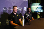 Colorado linebacker Nate Landman, left, and wide receiver Dimitri Stanley answer questions during the Pac-12 Conference NCAA college football Media Day Tuesday, July 27, 2021, in Los Angeles. (AP Photo/Marcio Jose Sanchez)