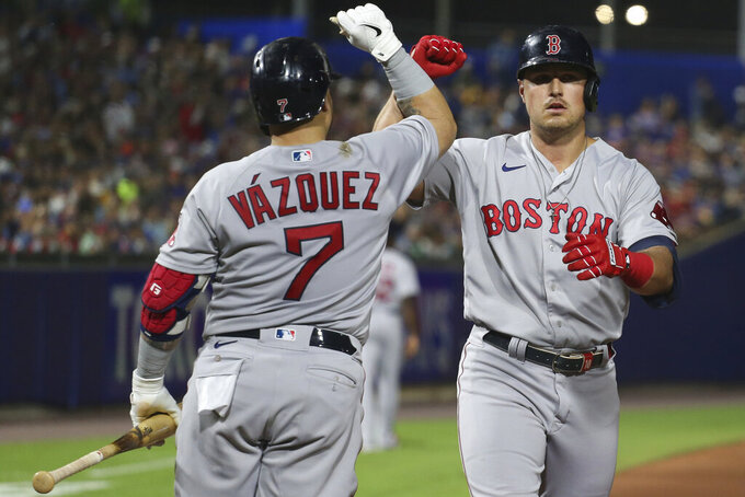 Boston Red Sox's Christian Vazquez (7) and Hunter Renfroe celebrate after Renfroe hit a home run during the eighth inning of the team's baseball game against the Toronto Blue Jays on Wednesday, July 21, 2021, in Buffalo, N.Y. (AP Photo/Joshua Bessex)