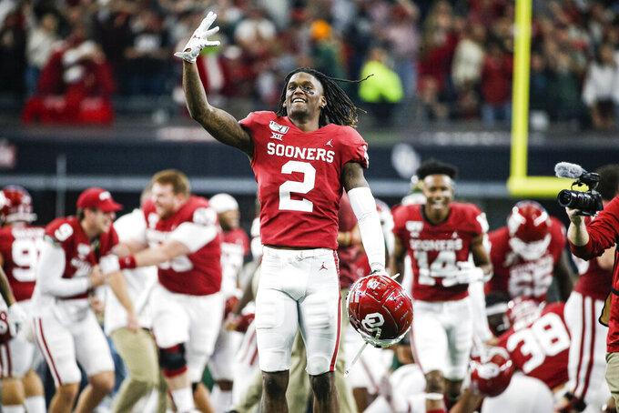 FILE - In this Dec. 7, 2019, file photo, Oklahoma wide receiver CeeDee Lamb (2) celebrates a 30-23 overtime win against Baylor during the Big 12 Championship game, in Arlington, Texas. Lamb was selected to The Associated Press All-America team, Monday, Dec. 16, 2019. (AP Photo/Brandon Wade, File)