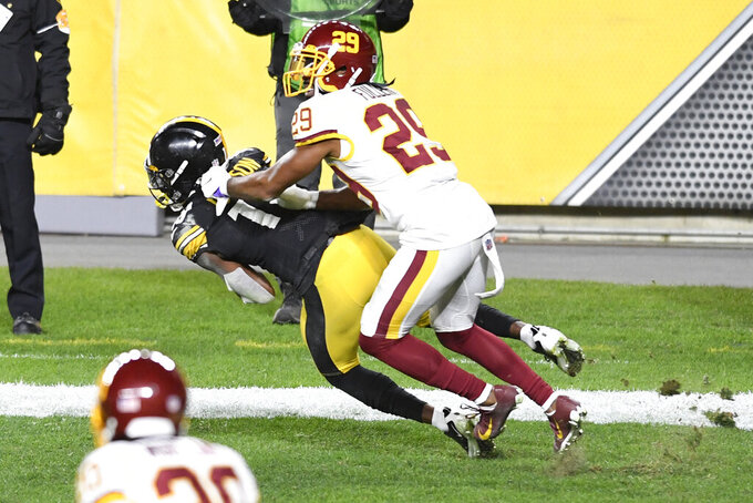 Pittsburgh Steelers wide receiver Diontae Johnson (18) catches a pass for a touchdown with Washington Football Team cornerback Kendall Fuller (29) defending during the first half of an NFL football game in Pittsburgh, Monday, Dec. 7, 2020. (AP Photo/Barry Reeger)