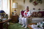 """Mae Krier, 95, of Levittown, Pa., an original """"Rosie the Riveter,"""" poses for a portrait in her home in Levittown, Pa., on Wednesday, July 28, 2021. Krier spent her time building airplanes for Boeing during World War II which earned her the title of Rosie the Riveter. She spent years getting other Rosies recognized.""""It is important for women to go after what they want or like because they are just as capable as a man,"""" Krier said. (Tyger Williams/The Philadelphia Inquirer via AP)"""