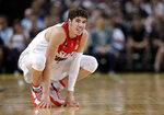 FILE- In this Nov. 17, 2019, file photo, LaMelo Ball of the Illawarra Hawks squats during their game against the Sydney Kings in the Australian Basketball League in Sydney. LaMelo Ball is expected to be one of the top picks in the NBA Draft, Wednesday, Nov. 18, 2020. (AP Photo/Rick Rycroft, File)