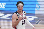 Gonzaga forward Corey Kispert (24) reacts after an Elite 8 game against Southern California in the NCAA men's college basketball tournament at Lucas Oil Stadium, Tuesday, March 30, 2021, in Indianapolis. Gonzaga won 85-66. (AP Photo/Michael Conroy)