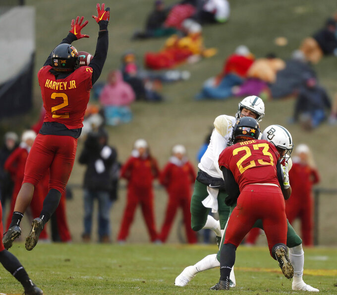Iowa State linebacker Willie Harvey, left, blocks a pass by Baylor quarterback Charlie Brewer, back right, during the first half of an NCAA college football game, Saturday, Nov. 10, 2018, in Ames. (AP Photo/Matthew Putney)