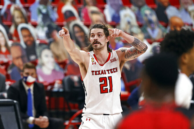Texas Tech's Avery Benson (21) gestures after hitting a 3-pointer during the second half of the team's NCAA college basketball game against Incarnate Word, Tuesday, Dec. 29, 2020, in Lubbock, Texas. (AP Photo/Brad Tollefson)