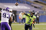 Seattle Seahawks quarterback Russell Wilson throws against the Minnesota Vikings during the second half of an NFL football game, Sunday, Oct. 11, 2020, in Seattle. (AP Photo/John Froschauer)
