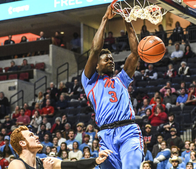 Mississippi forward Khadim Sy (3) dunks next to Butler forward John-Michael Mulloy (35) during an NCAA college basketball game in Oxford, Miss., Tuesday, Dec. 3, 2019. (Bruce Newman/The Oxford Eagle via AP)