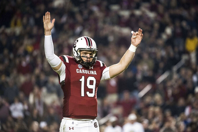 South Carolina quarterback Jake Bentley (19) celebrates a touchdown during the first half of the team's NCAA college football game against Chattanooga on Saturday, Nov. 17, 2018, in Columbia, S.C. (AP Photo/Sean Rayford)