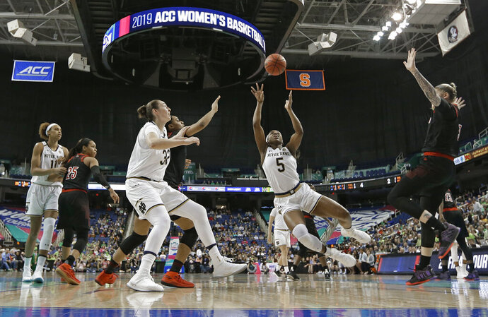 Notre Dame's Jackie Young (5) shoots against Louisville during the first half of an NCAA college basketball game in the championship of the Atlantic Coast Conference women's tournament in Greensboro, N.C., Sunday, March 10, 2019. (AP Photo/Chuck Burton)