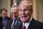 FILE- In this Tuesday, Nov. 13, 2018, file photo Sen. Bill Nelson, D-Fla., is joined by Senate Minority Leader Chuck Schumer, D-N.Y., left, at a news conference at the Capitol in Washington. Florida Republican Gov. Rick Scott is leading incumbent Nelson in the state's contentious Senate race. Official results posted by the state on Sunday, Nov. 18, showed Scott ahead of Nelson following legally-required hand and machine recounts. State officials will certify the final totals on Tuesday. (AP Photo/J. Scott Applewhite)
