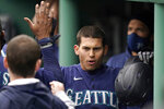 Seattle Mariners' Sam Haggerty is welcomed to the dugout after scoring on a double by Mariners' Tom Murphy in the fifth inning of a baseball game against the Boston Red Sox, Sunday, April 25, 2021, in Boston. (AP Photo/Steven Senne)