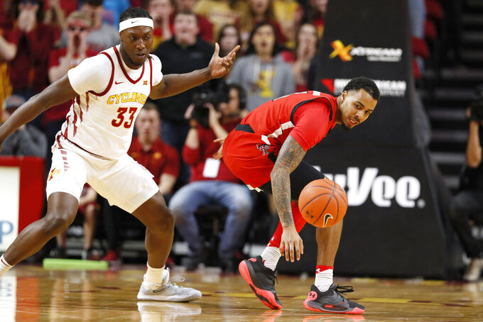 Texas Tech guard Kyler Edwards, right, runs down the ball ahead of Iowa State forward Solomon Young, left, during the first half of an NCAA college basketball game, Saturday, Feb. 22, 2020, in Ames, Iowa. (AP Photo/Charlie Neibergall)