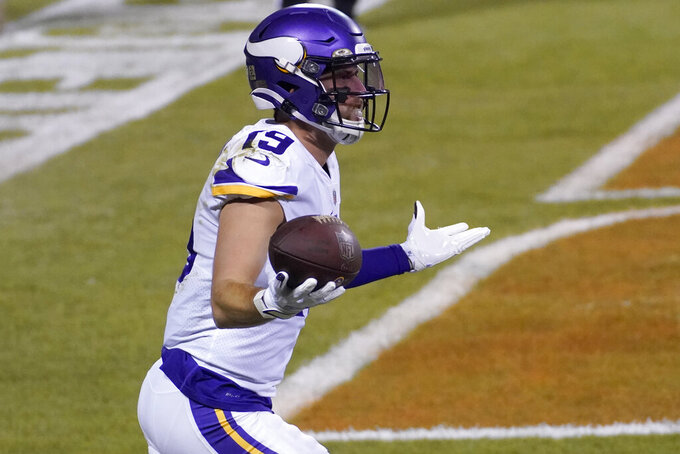 Minnesota Vikings wide receiver Adam Thielen (19) celebrates after catching a touchdown pass during the first half of an NFL football game against the Chicago Bears Monday, Nov. 16, 2020, in Chicago. (AP Photo/Charles Rex Arbogast)