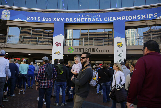 Fans line up to enter before an NCAA college basketball game between Montana and Eastern Washington in the championship of the Big Sky Tournament in Boise, Idaho, Saturday, March 16, 2019. (AP Photo/Otto Kitsinger)