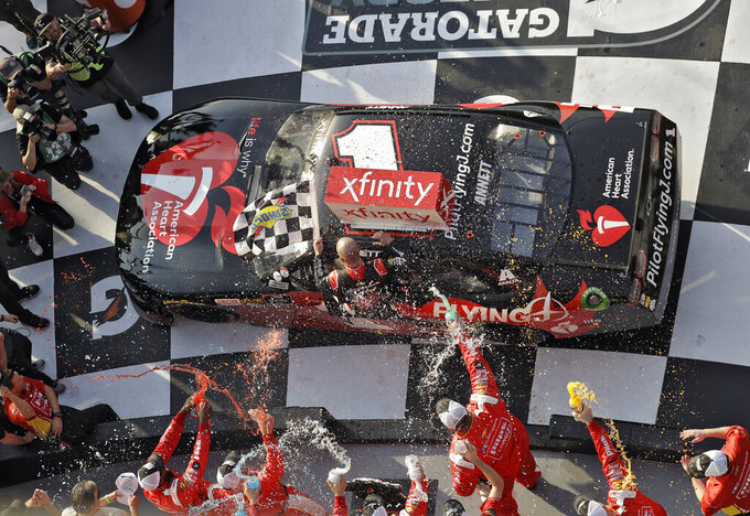 Michael Annett gets doused in Victory Lane after winning the NASCAR Xfinity auto race Saturday, Feb. 16, 2019, at Daytona International Speedway in Daytona Beach, Fla. (AP Photo/Chris O'Meara)