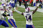 Buffalo Bills quarterback Josh Allen, second from left, celebrates his touchdown pass to Stefon Diggs, right, in the first half of an NFL football game against the New England Patriots, Monday, Dec. 28, 2020, in Foxborough, Mass. (AP Photo/Charles Krupa)