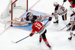 Edmonton Oilers goaltender Mikko Koskinen (19) makes a save against Chicago Blackhawks' Jonathan Toews (19) during the third period of an NHL hockey playoff game Wednesday, Aug. 5, 2020, in Edmonton, Alberta. (Codie McLachlan/The Canadian Press via AP)