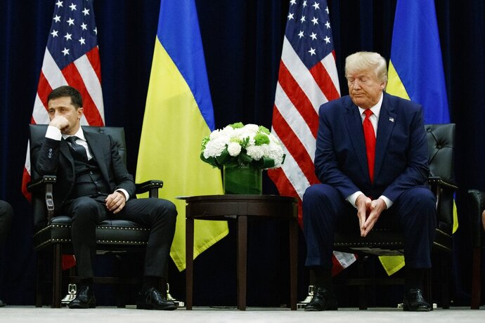 FILE - In this Sept. 25, 2019, file photo, President Donald Trump meets with Ukrainian President Volodymyr Zelenskiy at the InterContinental Barclay New York hotel during the United Nations General Assembly in New York. Ukraine may be at the center of a major geopolitical battle, but it's feeling increasingly alone and abandoned by its U.S. backers amid the impeachment drama unfolding in Washington. Facing that reality, Zelenskiy is reaching out to Russia directly in a bid to end the conflict before things get worse. (AP Photo/Evan Vucci, File)