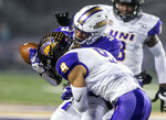 James Madison wide receiver Brandon Polk (3) drops a pass as he is tackled by Northern Iowa defensive back Xavior Williams (9) during the first half of a quarterfinal game in the NCAA college Football Championship Subdivision playoffs in Harrisonburg, Va., Friday, Dec. 13, 2019. (Daniel Lin/Daily News-Record via AP)