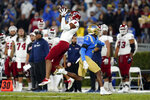 Fresno State wide receiver Ty Jones (8) makes a catch next to UCLA defensive back Cameron Johnson (3) during the first half of an NCAA college football game Saturday, Sept. 18, 2021, in Pasadena, Calif. (AP Photo/Marcio Jose Sanchez)