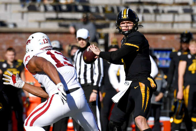 Missouri quarterback Connor Bazelak throws during the first half of an NCAA college football game against Arkansas Saturday, Dec. 5, 2020, in Columbia, Mo. (AP Photo/L.G. Patterson)