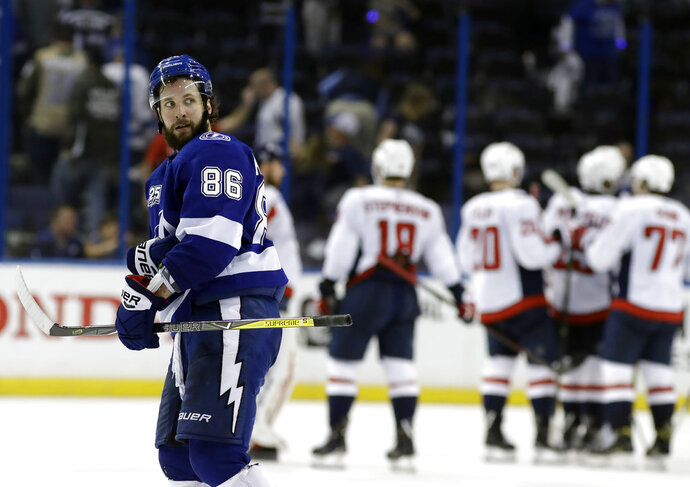 Tampa Bay Lightning right wing Nikita Kucherov (86) leaves the ice as the Washington Capitals celebrate their 6-2 win during Game 2 of the NHL Eastern Conference finals hockey playoff series Sunday, May 13, 2018, in Tampa, Fla. (AP Photo/Chris O'Meara)