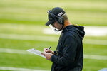 Indianapolis Colts head coach Frank Reich takes notes on the sideline in the first half of an NFL football game against the Baltimore Ravens in Indianapolis, Sunday, Nov. 8, 2020. (AP Photo/Darron Cummings)