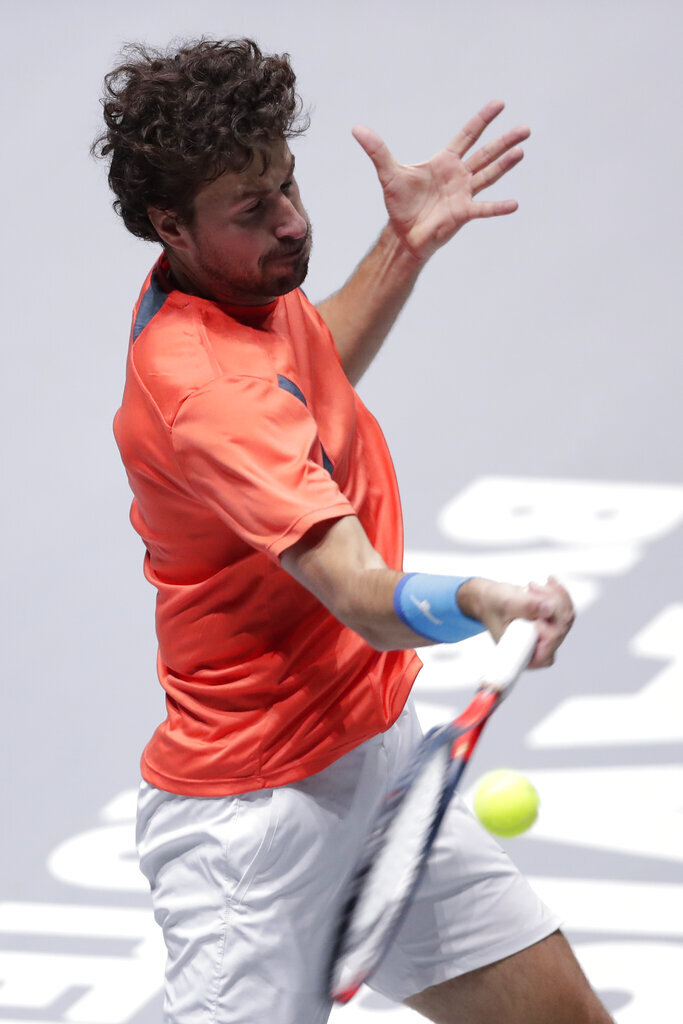 Robin Haase, of the Netherlands, returns the ball to Alexander Bublik, of Kazakhstan, during a Davis Cup tennis match in Madrid, Spain, Tuesday, Nov. 19, 2019. (AP Photo/Manu Fernandez)