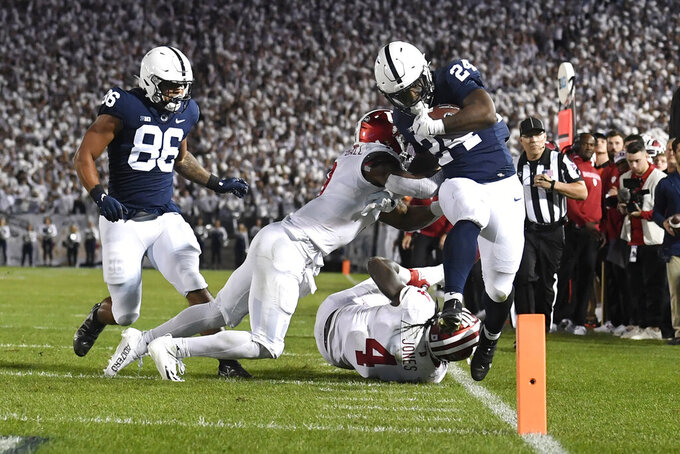 Penn State running back Keyvone Lee (24) is tackled by Indiana linebacker Cam Jones (4) in the first half of their NCAA college football game in State College, Pa., on Saturday, Oct. 2, 2021. (AP Photo/Barry Reeger)