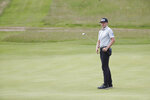 Canada's Mackenzie Hughes reacts after his putt on the 10 th green during the first round British Open Golf Championship at Royal St George's golf course Sandwich, England, Thursday, July 15, 2021. (AP Photo/Peter Morrison)