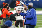 Cleveland Browns head coach Kevin Stefanski, left, shakes hands with New York Giants head coach Joe Judge after an NFL football game, Sunday, Dec. 20, 2020, in East Rutherford, N.J. The Browns won 20-6. (AP Photo/Corey Sipkin)