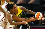 Washington Mystics' Ariel Atkins, left, and Seattle Storm's Mercedes Russell butt heads during the second quarter of a WNBA basketball game Tuesday, Sept. 7, 2021, in Everett, Wash. (Dean Rutz/The Seattle Times via AP)