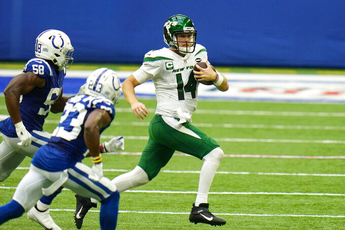 New York Jets quarterback Sam Darnold (14) is chased out of the pocket by Indianapolis Colts inside linebacker Bobby Okereke (58) and defensive back Kenny Moore II (23) in the second half of an NFL football game in Indianapolis, Sunday, Sept. 27, 2020. (AP Photo/AJ Mast)